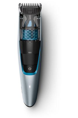 Tondeuse barbe - Système d'aspiration Rechargeable - 75 minutes d'autonomie 20 positions de coupe : de 0.5 à 10 mm Indicateur niveau de batterie