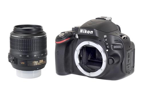 Nikon D5100 + 18-55 VR